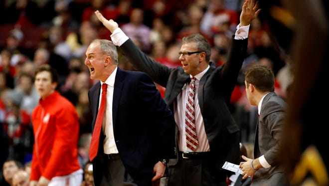 Ohio State Buckeyes head coach Thad Matta (left) and assistant Jeff Boals react during the second half of the Hawkeyes 71-65 win over the Ohio State Buckeyes at Value City Arena.