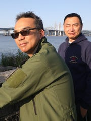 Lucian Chen, left, from Tarrytown and his cousin John Dong, visiting from Shanghai, came to Pierson Park in Tarrytown to check out the new Gov. Mario M. Cuomo bridge, Aug. 26, 2017.