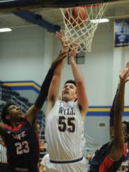 Wylie's Kyle Roberts (55) shoots as Life Waxahachie's