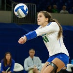 FGCU's Vanessa Benke serves against Fordham on Saturday during the Hilton Garden Inn and Homewood Suites Classic at Alico Arena in Fort Myers. FGCU beat Fordham 3-0.
