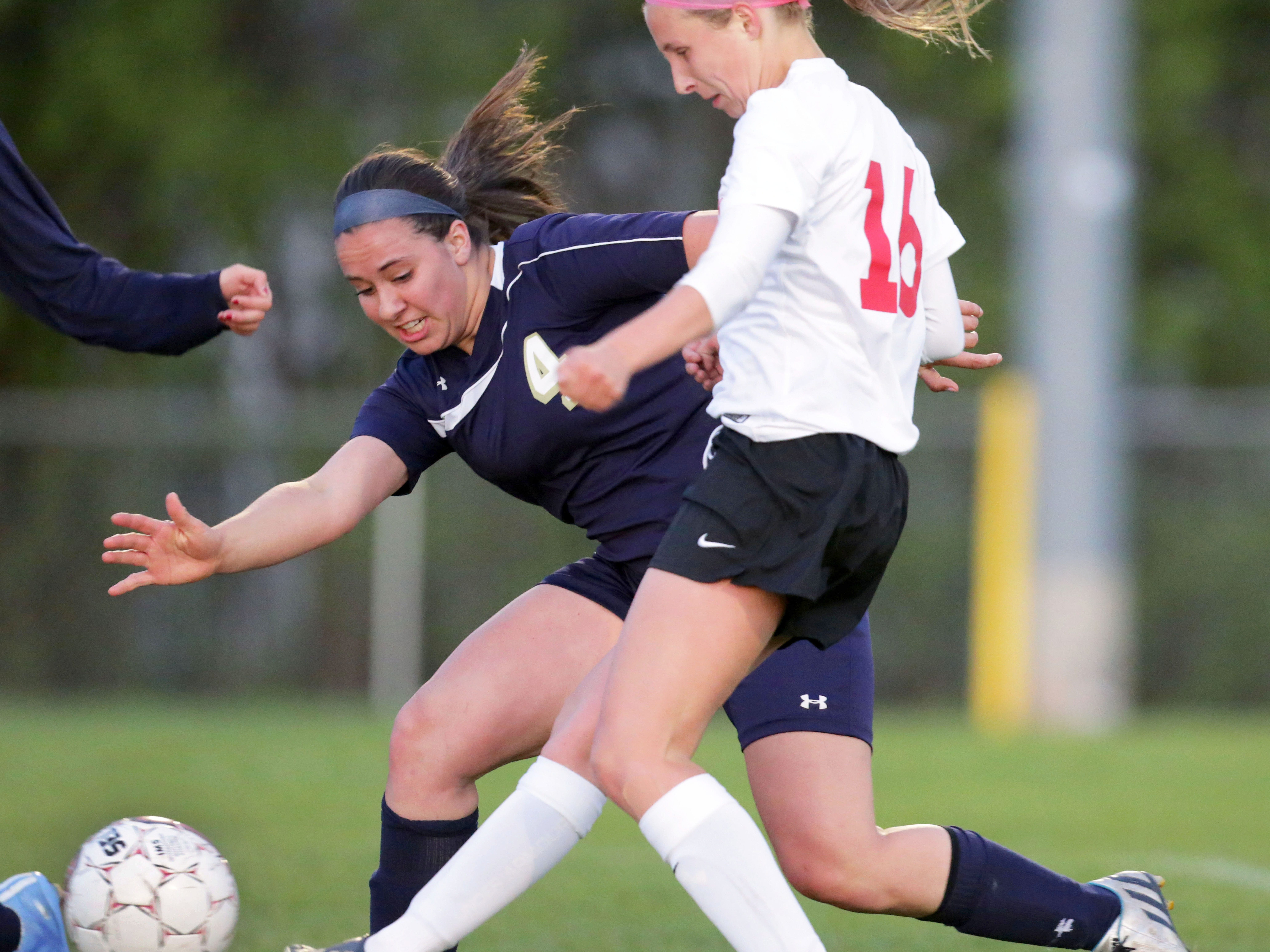 Rachel Sanderfoot of Kimberly (right) kicks the ball into the goal as Greta Brown of Appleton North tries for a stop during a Fox Valley Association girls' soccer game Tuesday in Kimberly.