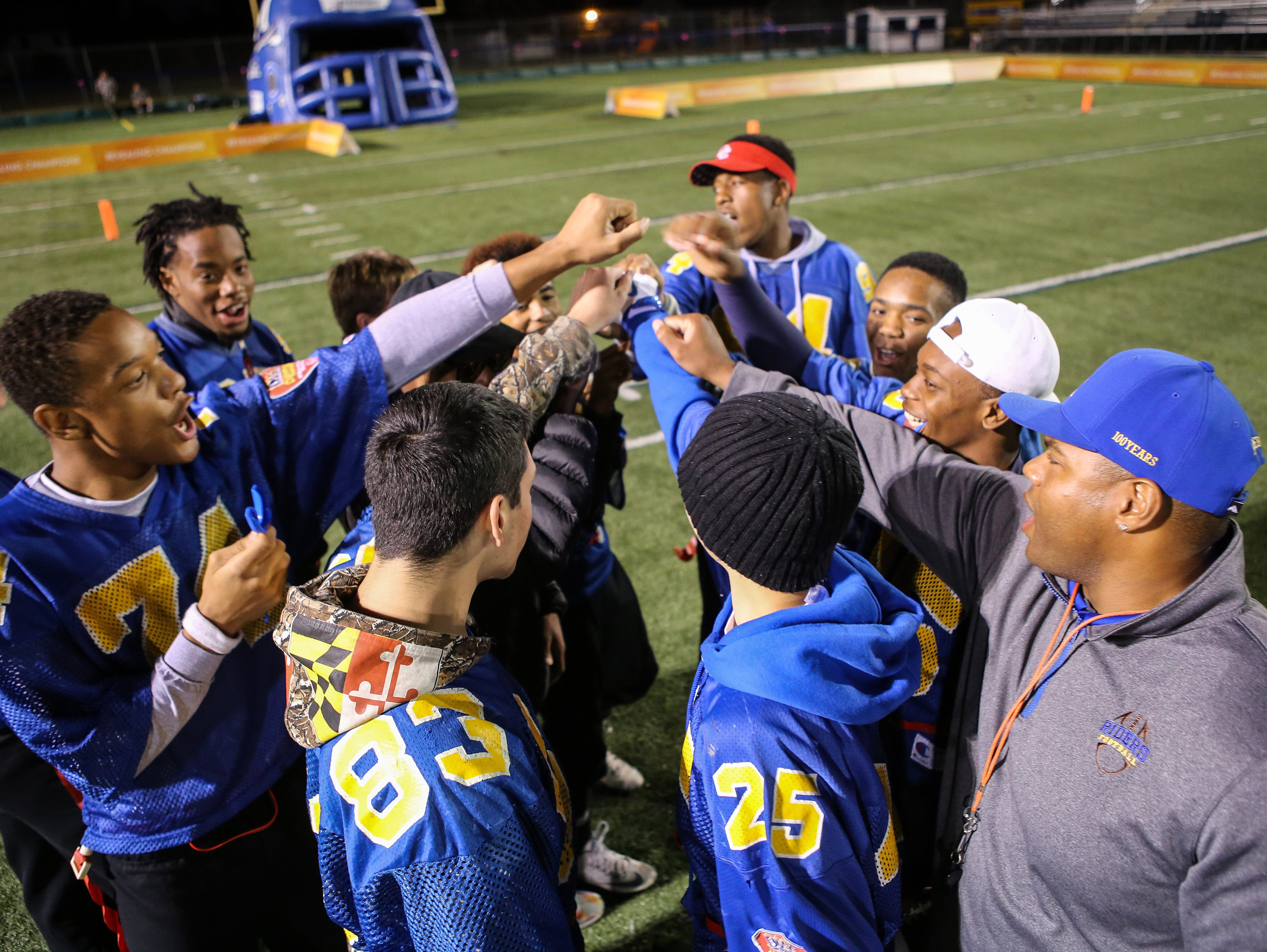 The Caesar Rodney Unified Football team huddles before the start of their game against Concord.