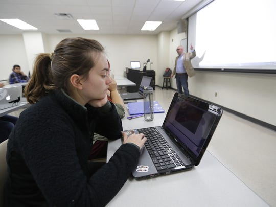 Mikaela Ryman takes notes on her laptop as Adam Gaines, University of Wisconsin-Green Bay associate professor of music, discusses an assignment for the class Exploring the Jazz Loft.