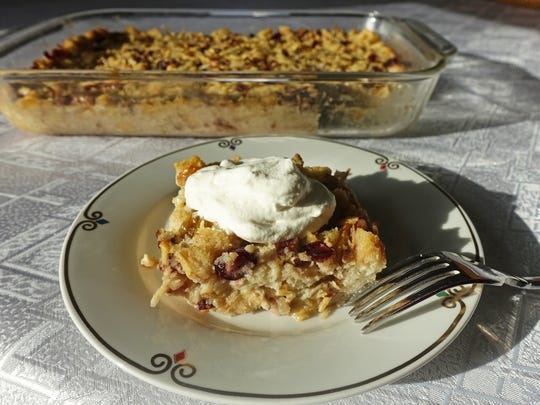 Apples, hickory nuts and dried cranberries combine deliciously in this homey bread pudding.