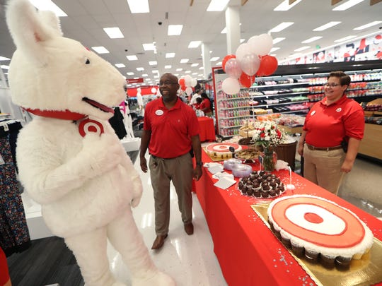 Target employees Rodney Austin, center, and Emily Young