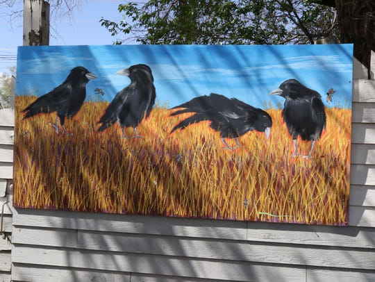 This mural is one of three that hangs on the fence