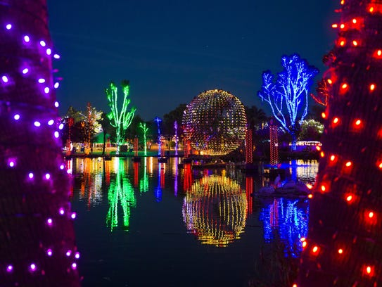 Displays illuminate the night at ZooLights at the Phoenix