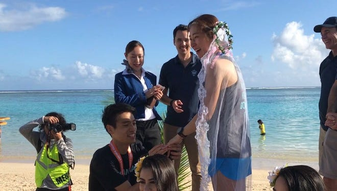 Byung-do Lee proposed to his girlfriend, Youngju Mok after finishing third in the men's division of the United Airlines Guam Marathon.