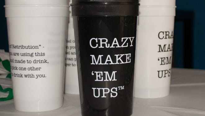 Merchandise from Crazy Make 'Em Ups, a new game from Tempe company Up Up Down Down Games.