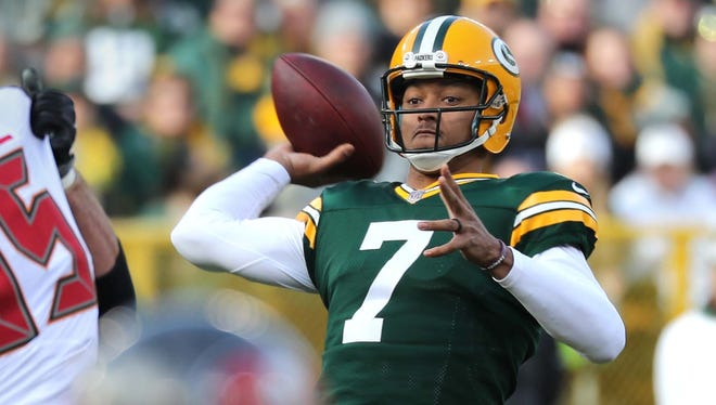 Green Bay Packers quarterback Brett Hundley (7) gets protection and looks for an open receiver against the Tampa Bay Buccaneers on Dec. 3, 2017, at Lambeau Field.