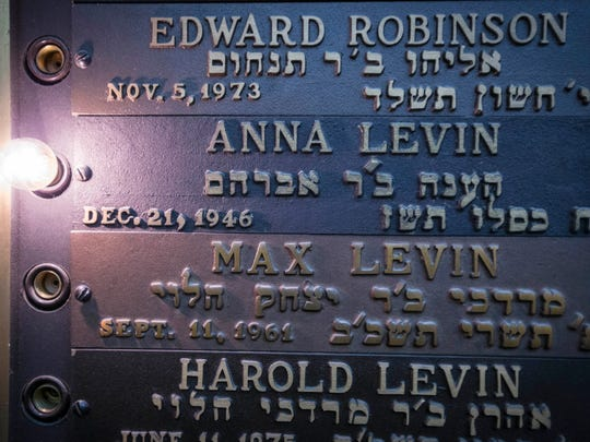 A memorial board in the chapel lights up the names of those who died in the current month at Beth El Jacob Synagogue in Des Moines Friday, Dec. 16, 2016.