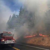 Yosemite wildfire closes highway, kills firefighter