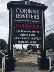 An electronic sign in front of Corinne Jewelers, bashing the Route 166 road project, has been praised by drivers who say it reflects their sentiments about the road project.
