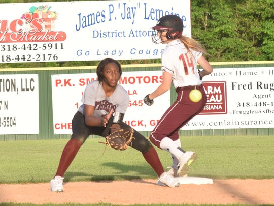 Grant's Natalie Farmer (14, right) steals second against Breaux Bridge and beats the throw to Gabrielle Jones (25, left).