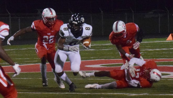 Tioga defenders try to stop Leesville running back D'ante Gallashaw (8) during last season's game.