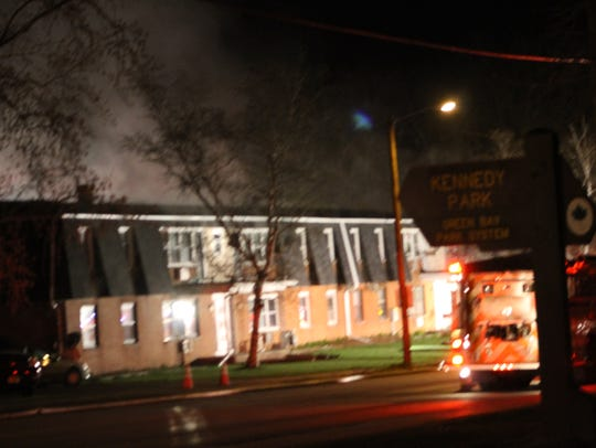 Smoke rises from the fire at 1011 N. Danz Ave.
