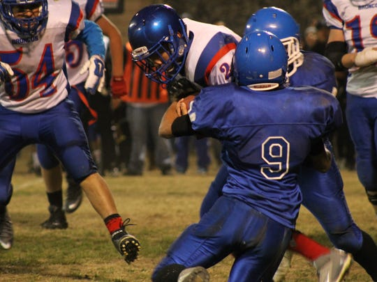 Hondo's Edwin Prudencio with the tackle.