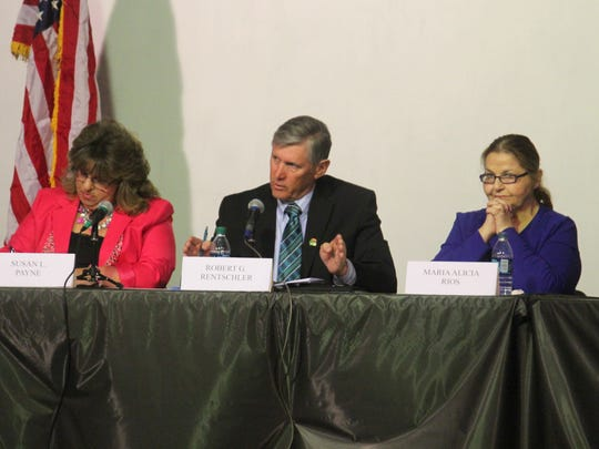 Robert Rentschler, incumbent for District 3, debates talks about the city's priorities during the debate.