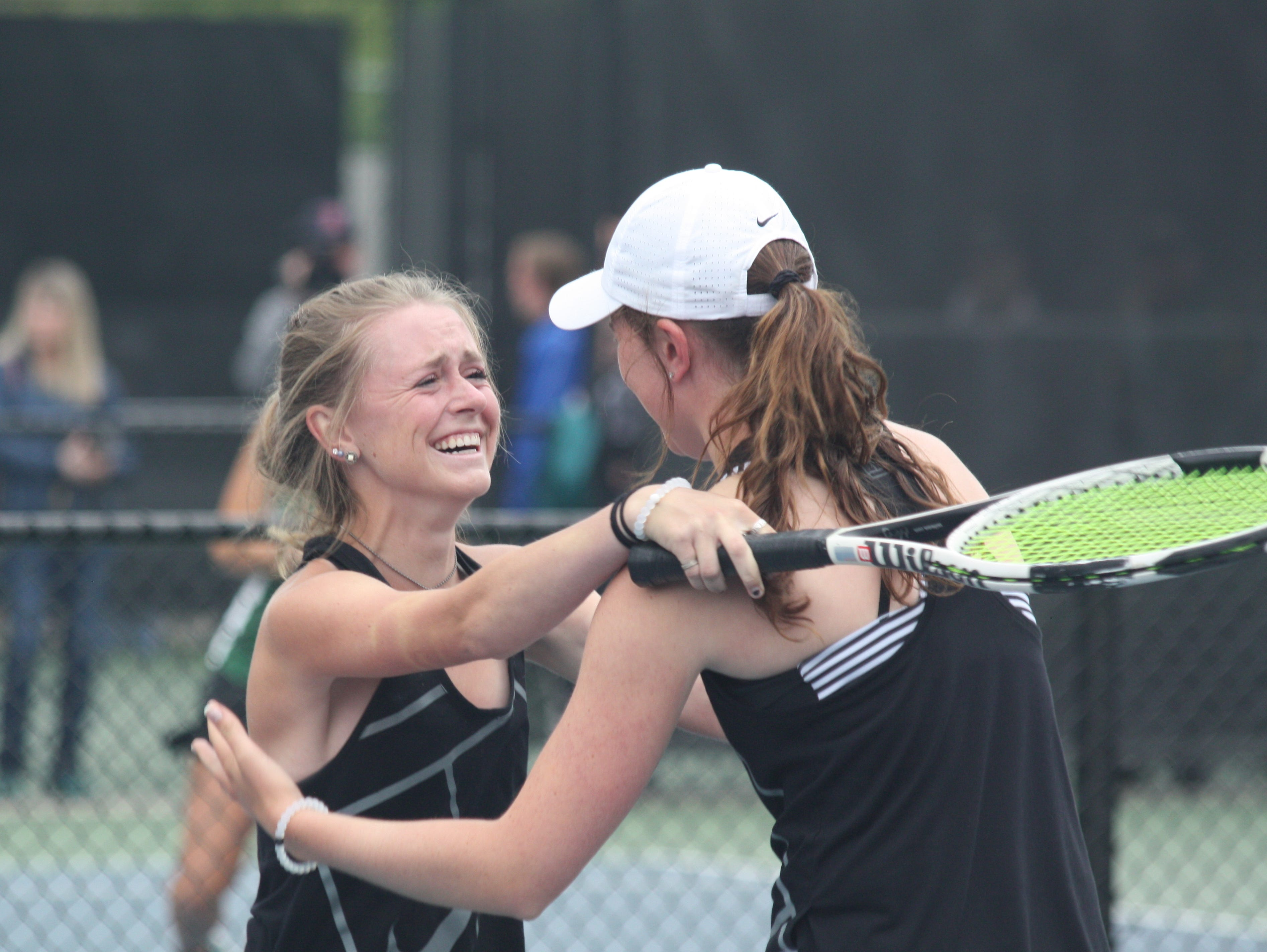 Fossil Ridge's Erinn Hogan, left, and Lindsey Noble celebrate winning a Class 5A state title at No. 3 doubles on Saturday.