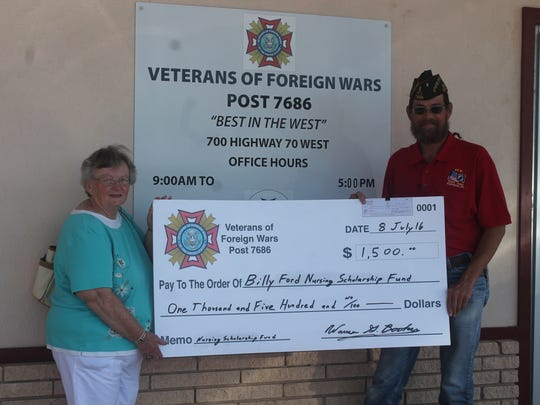 Chair member of the Billy Ford Nursing Scholarship Fund Beverly Ford (right) said the fund was dedicated in her husband's name who served in the U.S Air force and Post Cmdr. Warren Booker (left) and the VFW have been huge supporters.