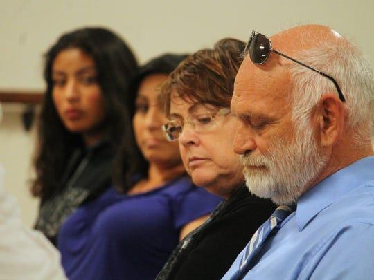 Alamogordo High School Principal George Heaton listens as upset parents speak to the Alamogordo Board of Education on Wednesday evening.