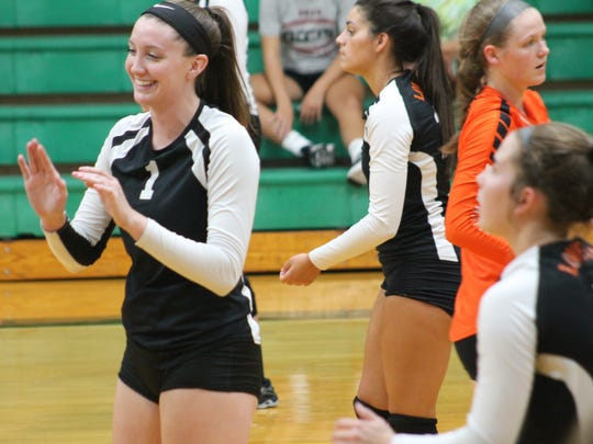 Loveland's Marie Plitt smiles during introductions against McNicholas last Aug. 22.