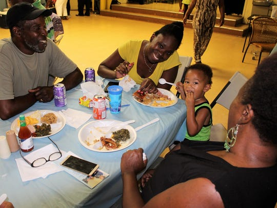 Fun, food and family being enjoyed by William Hazelton, left, La Rhonda Caples, Alonzo Graham and Lynette Hazelton at the Sept. 25 Family Day dinner, a collaborative effort between House of Hope, the Banner Lake Club, and Treasure Coast Food Bank.