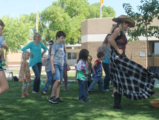 The Singing Cowgirl leads kids and parents in an old-time