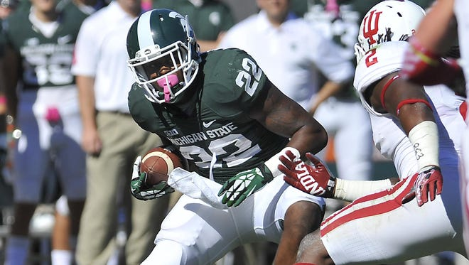 Rod Sanford/Lansing State JournalRunning back Delton Williams ran for 92 of his 238 yards as a true freshman last season in MSU's win at home over Indiana. MSU runnng back Delton Williams picks up some of his 92 yards against Indiana at Spartan Stadium in East Lansing Saturday 10/12/2013 . (Lansing State Journal | Rod Sanford)