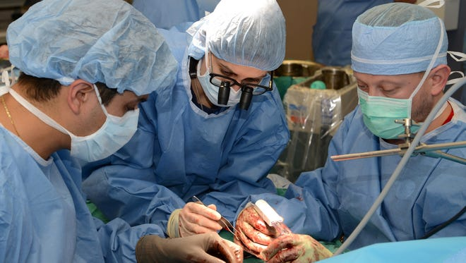Kleinert Kutz surgeons, Scott Farner, M.D., Elkin J. Galvis, M.D., and Christine M. Kleinert Institute fellow, Raquel Castro, M.D., join nerves and tendons.