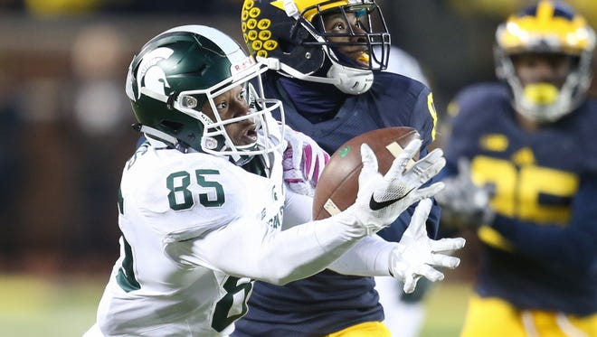 Michigan State WR Macgarrett Kings Jr is defended by Michigan DB Channing Stribling during the third quarter on Oct. 17 in Ann Arbor.