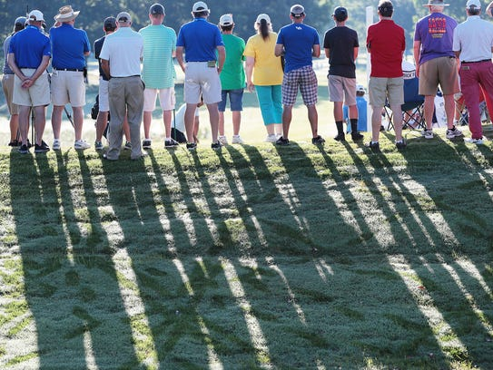 Golf fans line up on the 10th tee to watch Mickleson