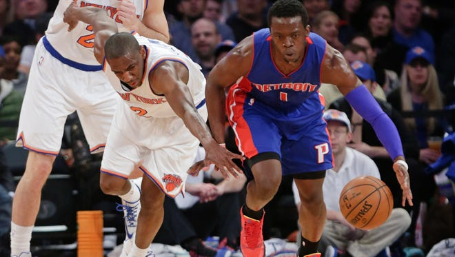 Detroit Pistons' Reggie Jackson (1) steals the ball from New York Knicks' Langston Galloway (2) during the first half of an NBA basketball game Wednesday, April 15, 2015, in New York.