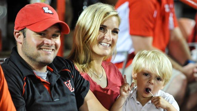 Cajun Fans David and Gretchen Vanicor with their son John-Thomas.