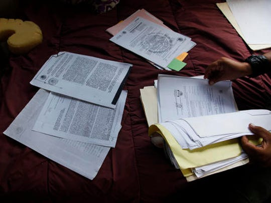 """In this July 2, 2016 photo, Luis Edgardo Charnichart Ortega, a childhood friend of Juan Carlos Soni Bulos, shows the paperwork of his legal case during an interview, in Tanquian de Escobedo, San Luis Potosi, Mexico. Charnichart who was taken and tortured along with his friend Soni says """"My mind, the psychologists say, they still have it,"""" he recounts. """"After they take you, nothing of you can remain. That is their objective, make you disappear, plant death inside you and leave it to consume you until the end of your days."""""""