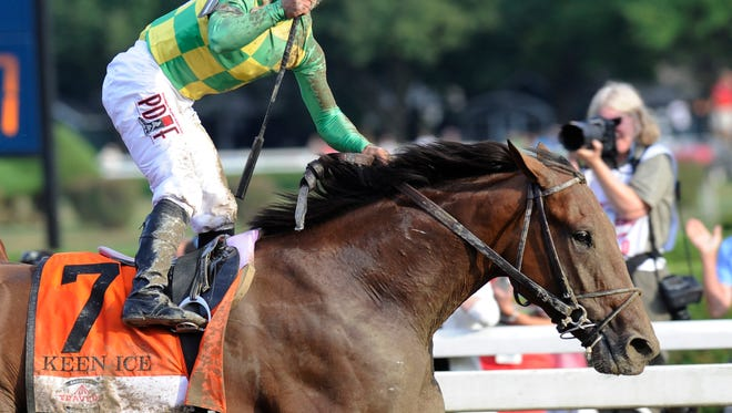 Javier Castellano celebrates after Keen Ice defeated Triple Crown winner American Pharoah to win the Travers Stakes horse race at Saratoga Race Course in Saratoga Springs, N.Y., Saturday, Aug. 29, 2015. (AP Photo/Hans Pennink)