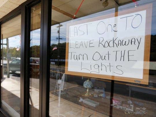 """On a sign hanging in the front window of a flea market that no longer opens, there's a handwritten request: """"Last one to leave Rockaway turn out the lights."""""""
