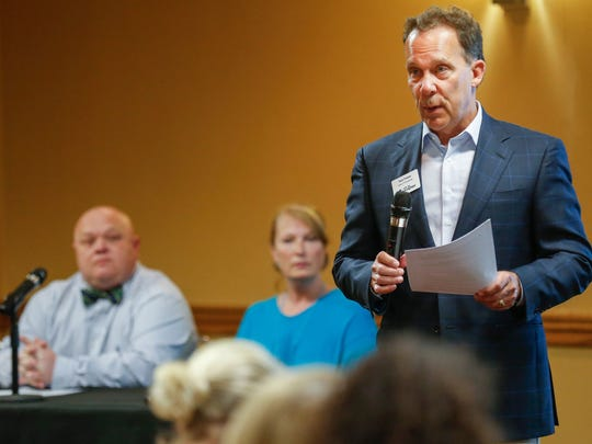 Zone 2 councilman Tom Prater speaks at a recent public discussion of a multi-agency outreach effort at a homeless camp on East Kearney. Behind him are Jennifer Cannon with Gathering Friends and Randy McCoy with The Kitchen, Inc.