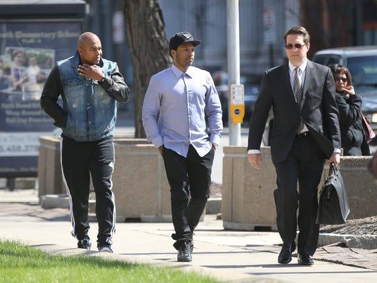 April 2015: Mendeecees Harris, center, walks into federal