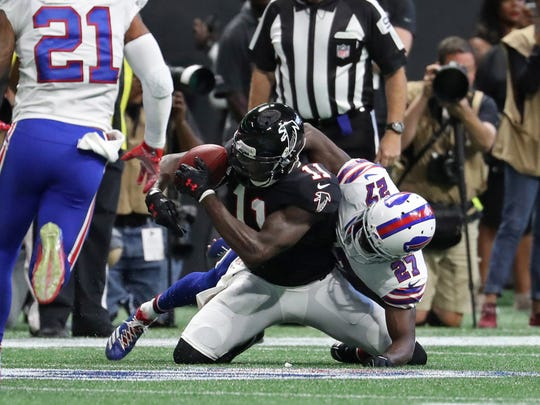 Atlanta Falcons wide receiver Julio Jones (11) is tackled after a catch by Buffalo Bills cornerback Tre'Davious White (27).