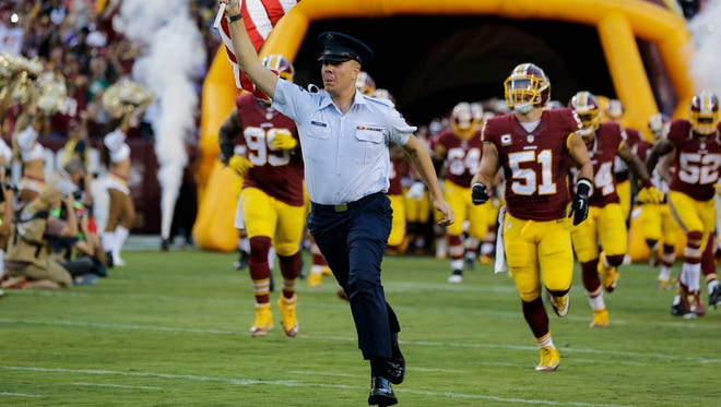 Isaiah Ehlinger leads the Washington Redskins onto the football field in September 2016. The Kimball native is a member of the U.S. Air Force Honor Guard, and will be a part of a joint honor guard at Super Bowl LI on Sunday, Feb. 5, in Houston.