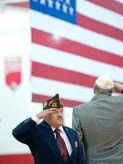 Rodger Vrodman salutes the flag during the opening