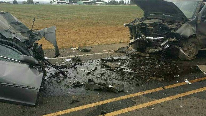 A crash on Highway 211 on Monday morning left one woman dead and two other people injured.