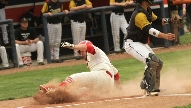 Plymouth's Seth Bailey slides into home plate during the district final against South Central at Galion on Friday.