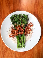 Charred Broccolini with tahini sauce and roasted almonds