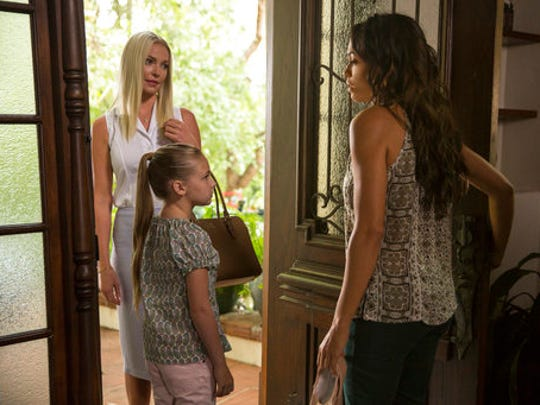 "This image released by Warner Bros. Pictures shows Katherine Heigl, from left, Isabella Kai Rice and Rosario Dawson in a scene from, ""Unforgettable."""