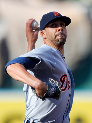 Detroit Tigers' David Price throws to the plate during