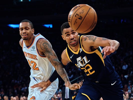 Utah Jazz's Joe Ingles, right, competes for the ball with New York Knicks' Lance Thomas (42) during the first half of an NBA basketball game at Madison Square Garden in New York, Wednesday, Nov. 15, 2017. (AP Photo/Andres Kudacki)