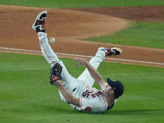 Houston Astros starting pitcher Justin Verlander tries to make a play on a ball hit by Washington Nationals' Ryan Zimmerman during the fourth inning of Game 2 of the baseball World Series Wednesday, Oct. 23, 2019, in Houston. (AP Photo/Eric Gay)