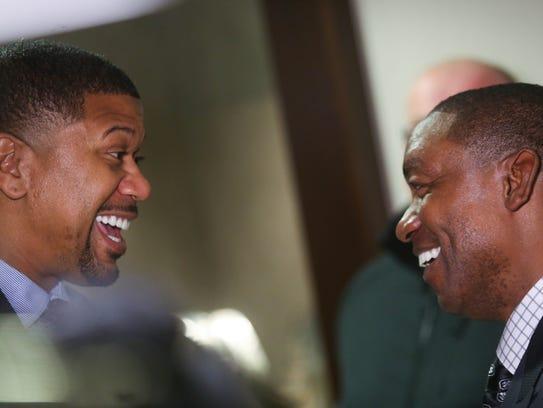 Former NBA player Jalen Rose (left) talks with former